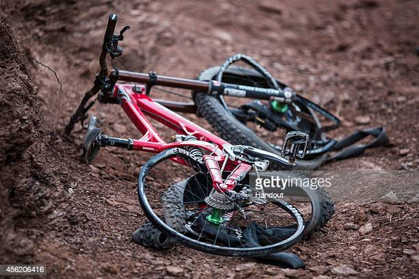 In this handout image provided by Red Bull Kelly McGarry of New Zealand's bike after a crash during practice for Red Bull Rampage freeride event on...