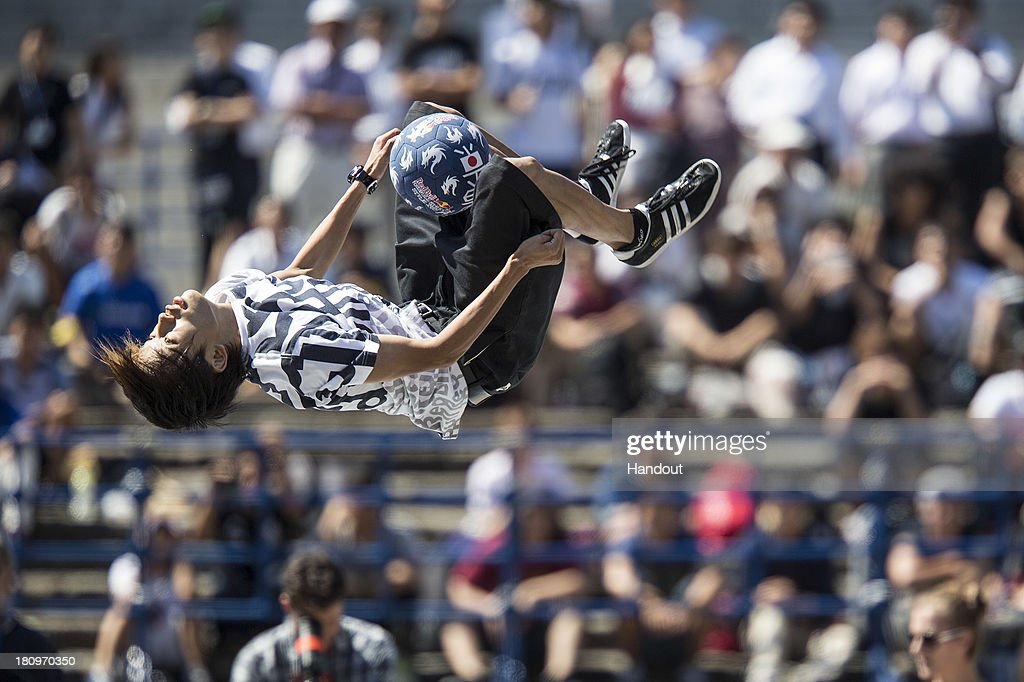 In this handout image provided by Red Bull, Kotaro Tokuda of Japan in action during qualifications at Zojoji Temple in build up for the Red Bull Street Style freestyle football world finals on September 18, 2013 in Tokyo, Japan.
