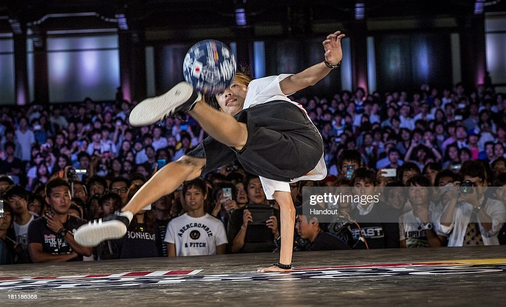 In this handout image provided by Red Bull, Kotaro Tokuda of Japan competes during the Red Bull Street Style freestyle football world finals on September 19, 2013 at Tokyo, Japan.