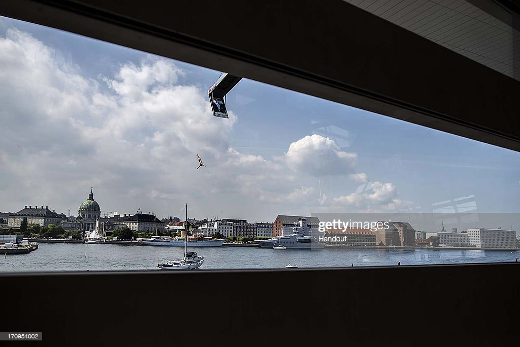 In this handout image provided by Red Bull, Kris Kolanus of Poland dives from the 28 metre platform on the roof of the Copenhagen Opera House during the first practice session of second stop of the Red Bull Cliff Diving World Series on June 20, 2013 at Copenhagen, Denmark.