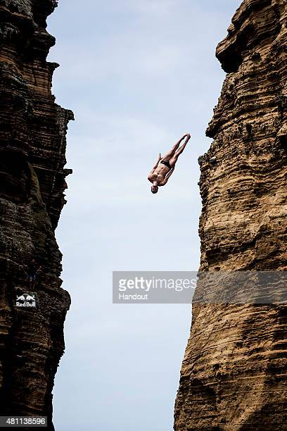 In this handout image provided by Red Bull Kyle Mitrione of the USA dives from the 27 metre platform during the first training session of the fifth...