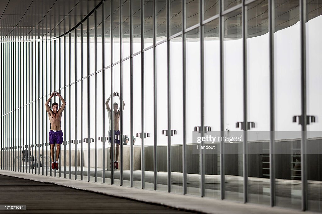 In this handout image provided by Red Bull, Matt Cowen of the United Kingdom warms up on a balcony at the Copenhagen Opera House prior to the first round of the second stop of the Red Bull Cliff Diving World Series on June 21, 2013 at Copenhagen, Denmark.