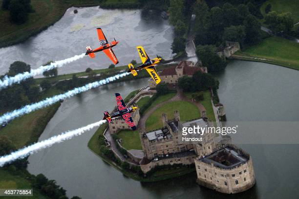 In this handout image provided by Red Bull Matt Hall of Australia and Nicolas Ivanoff of France fly in formation with Kirby Chambliss of the United...
