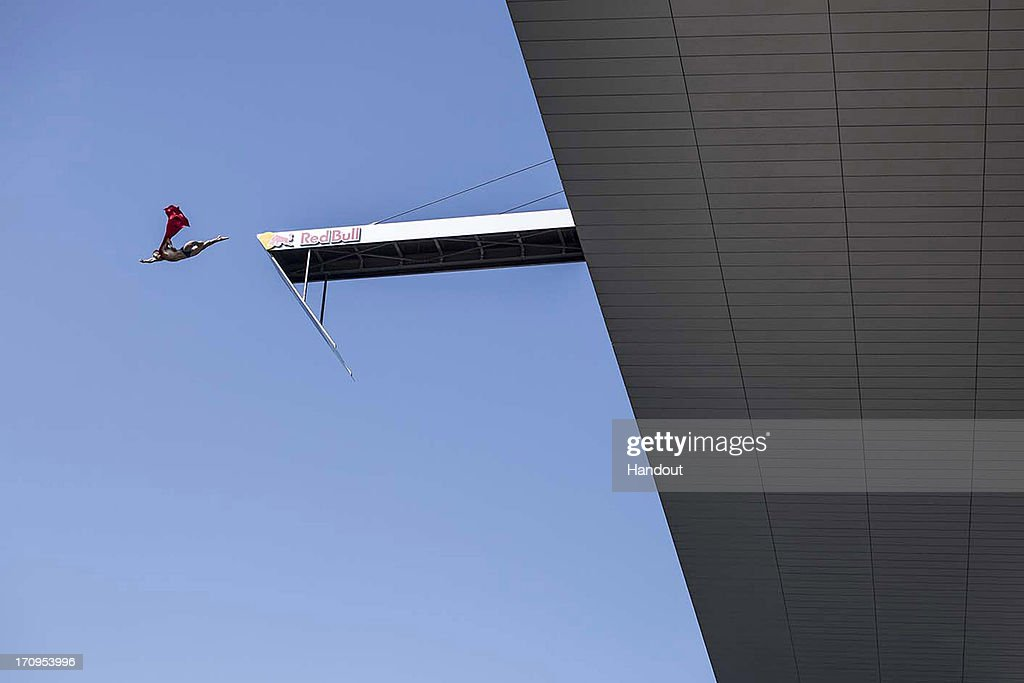 In this handout image provided by Red Bull, Michal Navratil of the Czech Republic performs his Superman dive from the 28 metre platform on the roof of the Copenhagen Opera House during the first practice session of second stop of the Red Bull Cliff Diving World Series on June 20, 2013 at Copenhagen, Denmark.