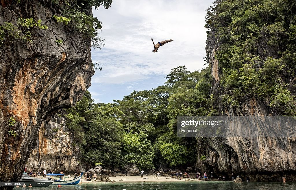 In this handout image provided by Red Bull, Michal Navratil of the Czech Republic dives from the 27 metre platform on Hong Island in the Andaman Sea during the last competition day of the eighth and final stop of the 2013 Red Bull Cliff Diving World Series on October 26, 2013 at Krabi, Thailand.