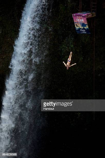 In this handout image provided by Red Bull Michal Navratil of the Czech Republic dives from the 27 metre platform next to Rininahue waterfall during...