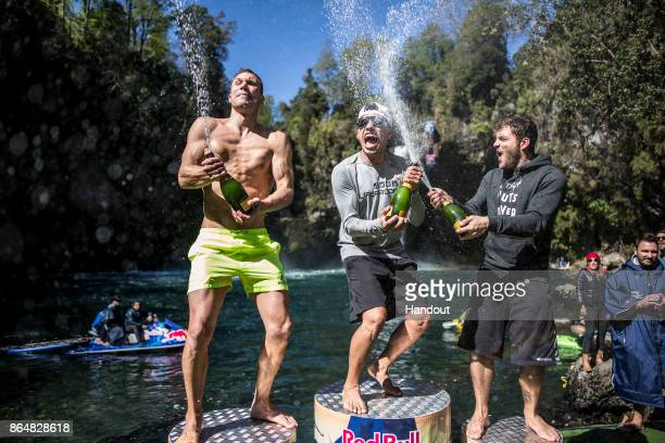 In this handout image provided by Red Bull Michal Navratil of the Czech Republic Jonathan Paredes of Mexico and Alessandro De Rose of Italy celebrate...
