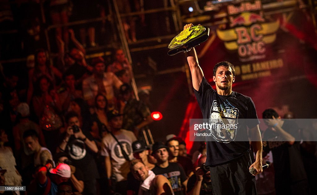 In this handout image provided by Red Bull, Monnir 'Mounir' Biba of France holds up his trophy after winning the Red Bull BC One breakdancing world finals at the Fundicao Progresso on December 8, 2012 in Rio de Janeiro, Brazil.