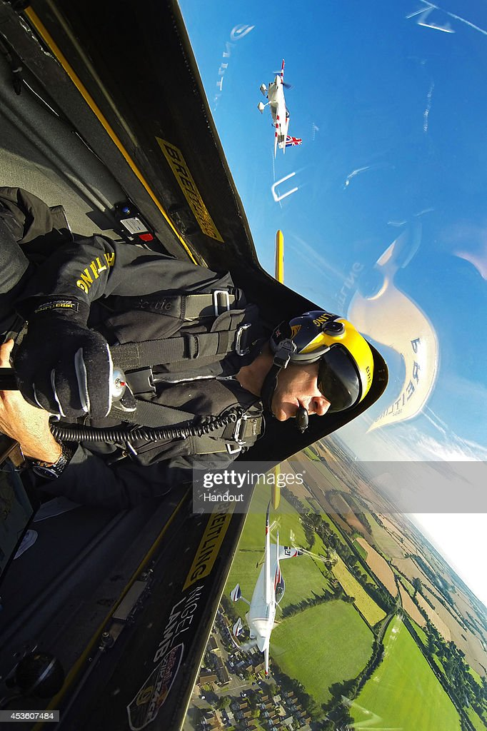 In this handout image provided by Red Bull, Nigel Lamb of Great Britain flies prior to the fifth stage of the Red Bull Air Race World Championship in front of the cliffs of Dover on August 14, 2014 near Dover, United Kingdom.