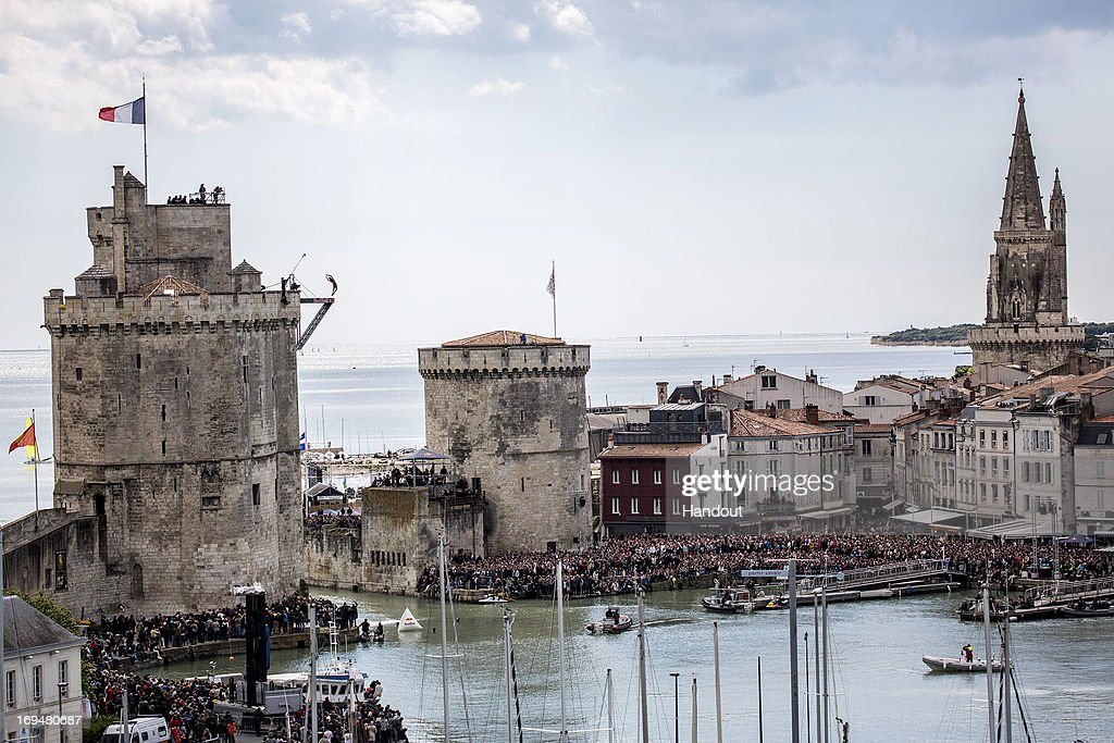 In this handout image provided by Red Bull, Orlando Duque of Colombia dives from the 27.5 metre platform on the Saint Nicolas Tower during the first stop of the Red Bull Cliff Diving World Series on May 25, 2013 at La Rochelle, France.