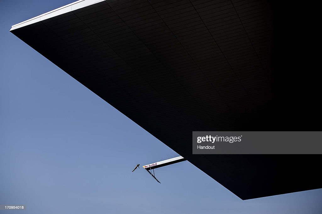 In this handout image provided by Red Bull, Orlando Duque of Colombia dives from the 28 metre platform on the roof of the Copenhagen Opera House during the first practice session of second stop of the Red Bull Cliff Diving World Series on June 20, 2013 at Copenhagen, Denmark.