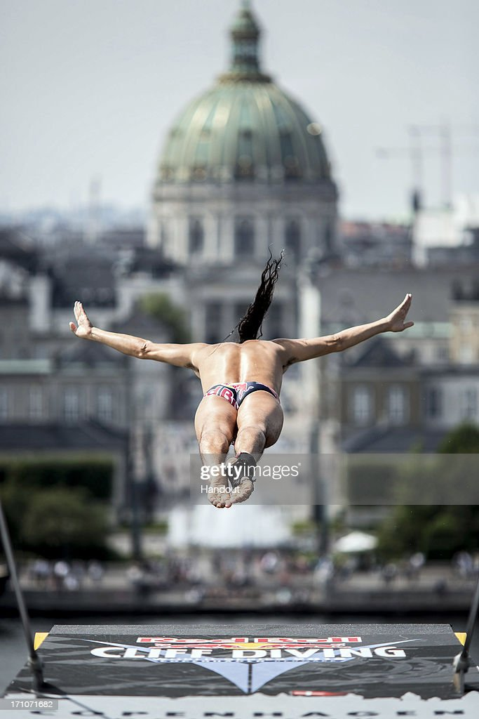 In this handout image provided by Red Bull, Orlando Duque of Colombia dives from the 28-metre platform at the Copenhagen Opera House during the second practice session of the second stop of the Red Bull Cliff Diving World Series on June 21, 2013 at Copenhagen, Denmark.