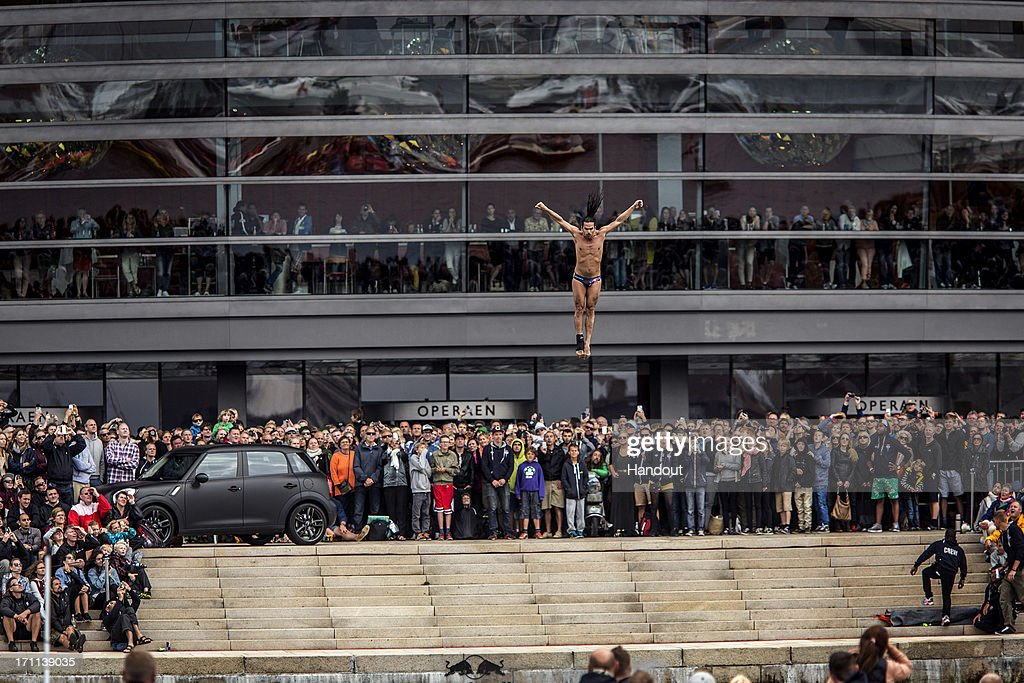 In this handout image provided by Red Bull, Orlando Duque of Colombia prepares for his water entry after diving from the 28 metre platform at the Copenhagen Opera House during the second stop of the Red Bull Cliff Diving World Series on June 22, 2013 at Copenhagen, Denmark.