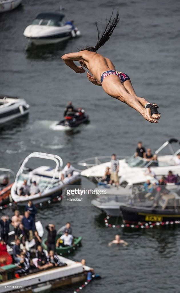 In this handout image provided by Red Bull, Orlando Duque of Colombia dives from the 28 metre platform at the Copenhagen Opera House during the second stop of the Red Bull Cliff Diving World Series on June 22, 2013 at Copenhagen, Denmark.