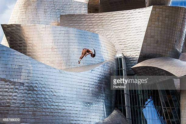 In this handout image provided by Red Bull Orlando Duque of Colombia dives from the 27 metre platform on La Salves Bridge next to the Guggenheim...