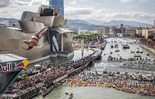 In this handout image provided by Red Bull Orlando Duque of Colombia dives from the 275 metre platform on La Salve bridge during the eighth and final...