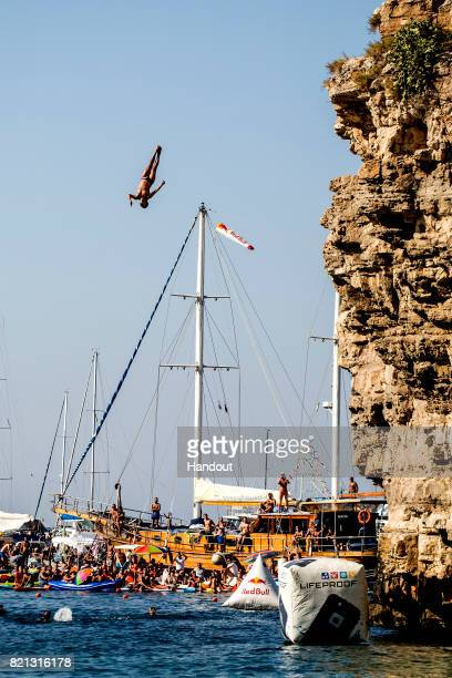 In this handout image provided by Red Bull Orlando Duque of Colombia dives from the 27 platform during the third stop of the Red Bull Cliff Diving...