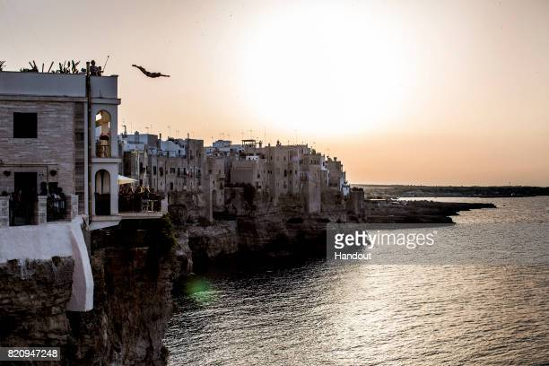 In this handout image provided by Red Bull Owen Weymouth of the UK dives from a 25 metre terrace at Casa Favale after the first training session of...