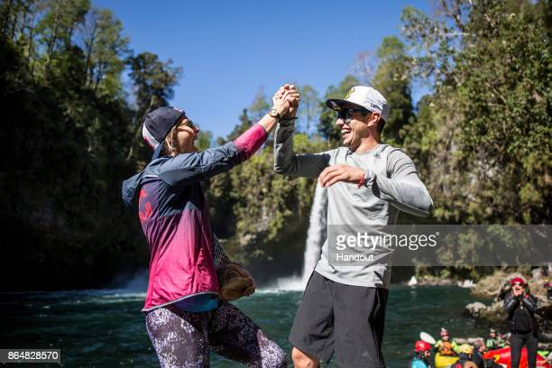In this handout image provided by Red Bull Rhiannan Iffland of Australia and Jonathan Paredes of Mexico congratulate each other after winning their...