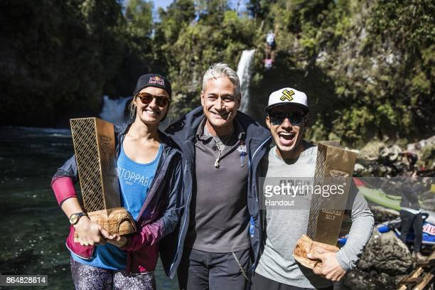 In this handout image provided by Red Bull Rhiannan Iffland of Australia and Jonathan Paredes of Mexico pose with sports director Greg Louganis of...