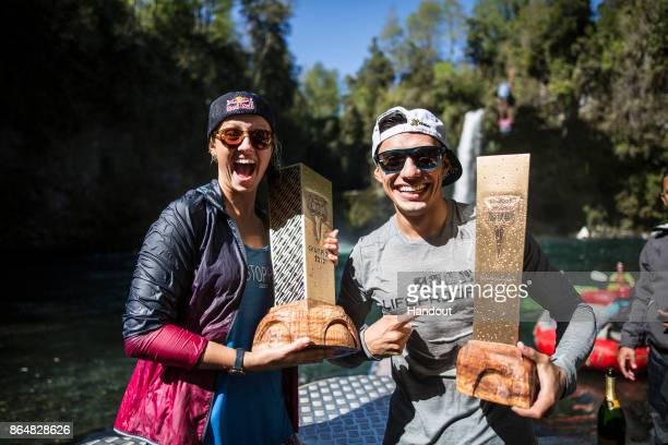 In this handout image provided by Red Bull Rhiannan Iffland of Australia and Jonathan Paredes of Mexico celebrate with the World Series trophies...