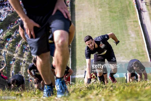 In this handout image provided by Red Bull Romain Simon of France makes his way up the 400 metre long ski jump course with 140 metres of elevation at...