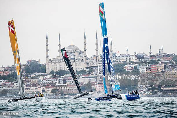 In this handout image provided by Red Bull SAP Extreme Sailing Team of Denmark Lino Sonego Team Italia of Italy and The Wave Muscat of Oman compete...