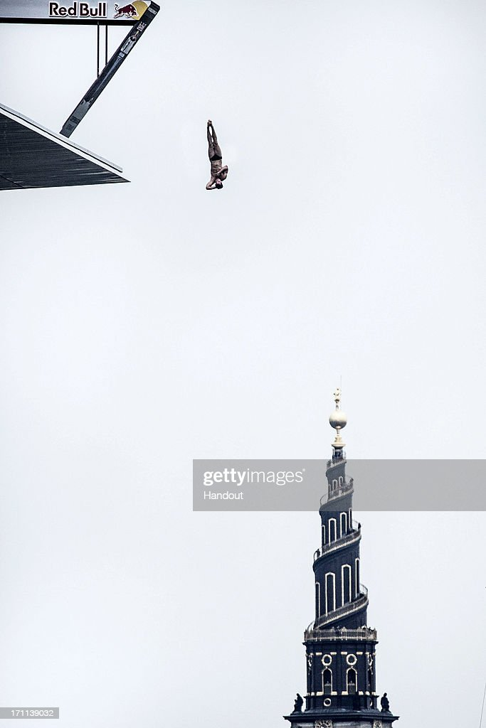 In this handout image provided by Red Bull, Sasha Kutsenko of the UK dives from the 28 metre platform at the Copenhagen Opera House during the second stop of the Red Bull Cliff Diving World Series on June 22, 2013 at Copenhagen, Denmark.