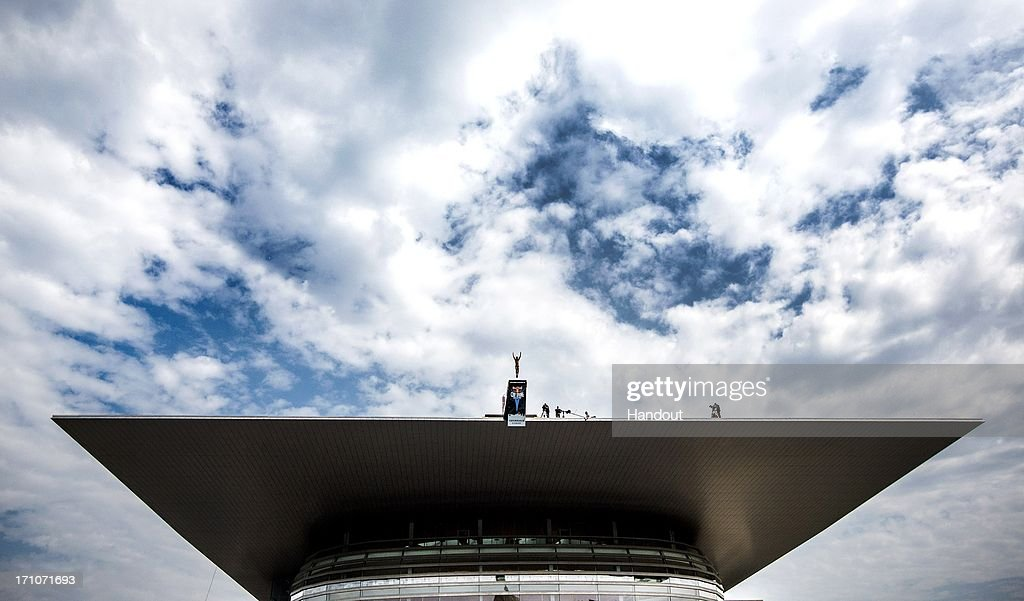 In this handout image provided by Red Bull, Sasha Kutsenko of Ukraine dives from the 28-metre platform at the Copenhagen Opera House during the first round of the second stop of the Red Bull Cliff Diving World Series on June 21, 2013 at Copenhagen, Denmark.