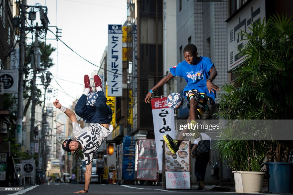 In this handout image provided by Red Bull, Sean Garnier (L) of France and Beh Abdoul Kader Kone (R) of the Ivory Coast practice in the streets of Shiba Koen in preparation for the Red Bull Street Style freestyle football world finals on September 17, 2013 in Tokyo, Japan.