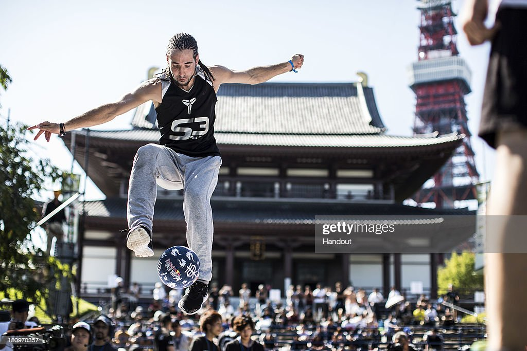 In this handout image provided by Red Bull, Sean Garnier of France in action during qualifications at Zojoji Temple in build up for the Red Bull Street Style freestyle football world finals on September 18, 2013 in Tokyo, Japan.