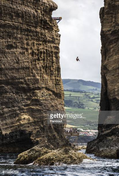 In this handout image provided by Red Bull Sergio Guzman of Mexico dives from the 27 metre platform at Islet Franca do Campo during the second stop...