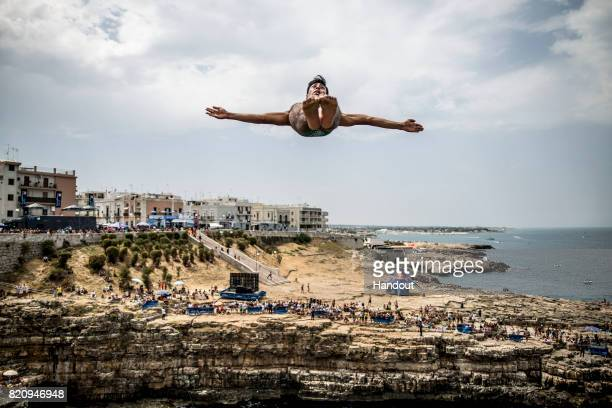 In this handout image provided by Red Bull Sergio Guzman of Mexico dives from the 27 metre platform during the first competition day of the third...