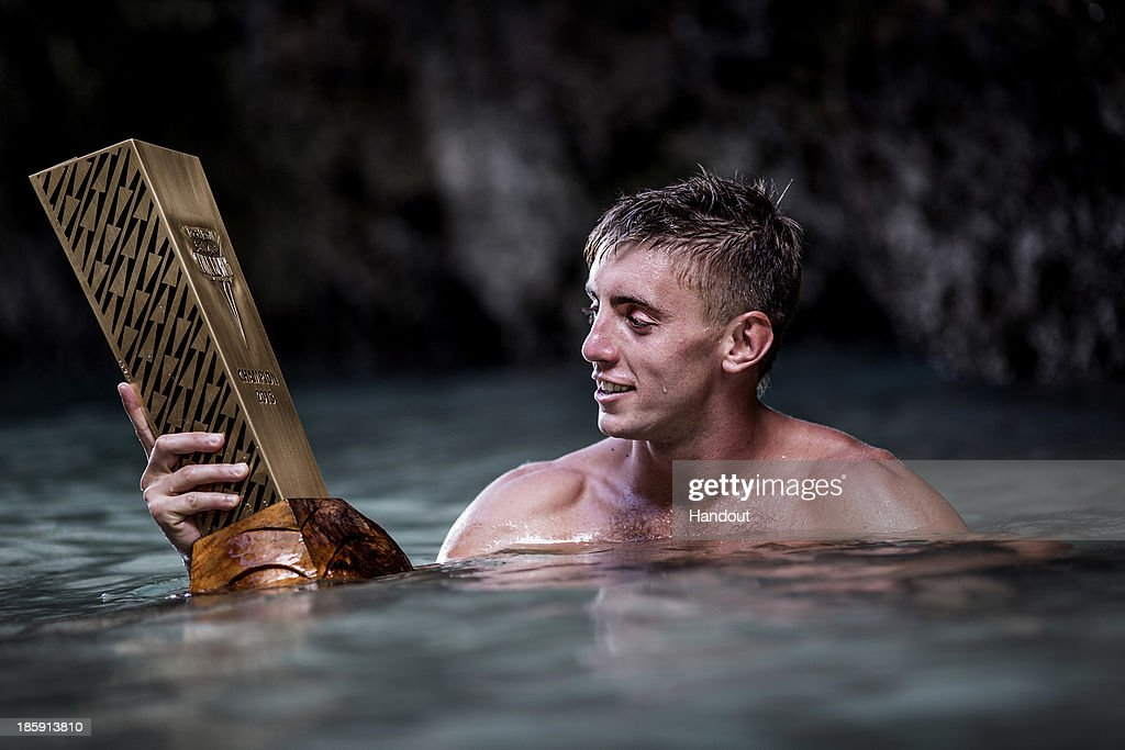 In this handout image provided by Red Bull, Series winner Artem Silchenko of Russia with the Championship trophy on Hong Island in the Andaman Sea after the last competition day of the eighth and final stop of the 2013 Red Bull Cliff Diving World Series on October 26, 2013 at Krabi, Thailand.