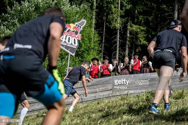 In this handout image provided by Red Bull Spectators from a local marching band cheer on competitors as they make their way up the 400 metre long...
