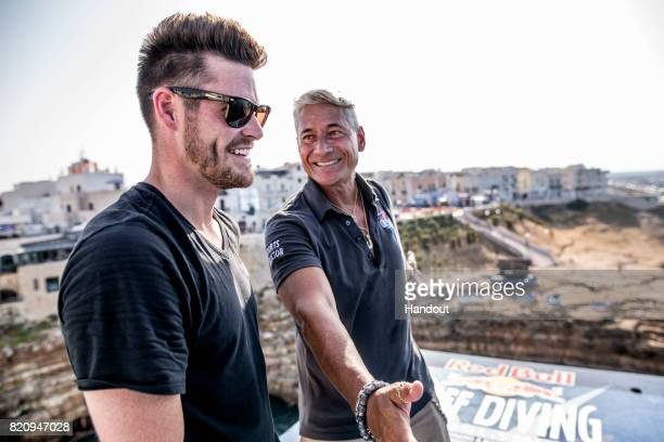 In this handout image provided by Red Bull Sports Director Greg Louganis and Event Commentator David Boudia of the USA talk on the 27 metre platform...