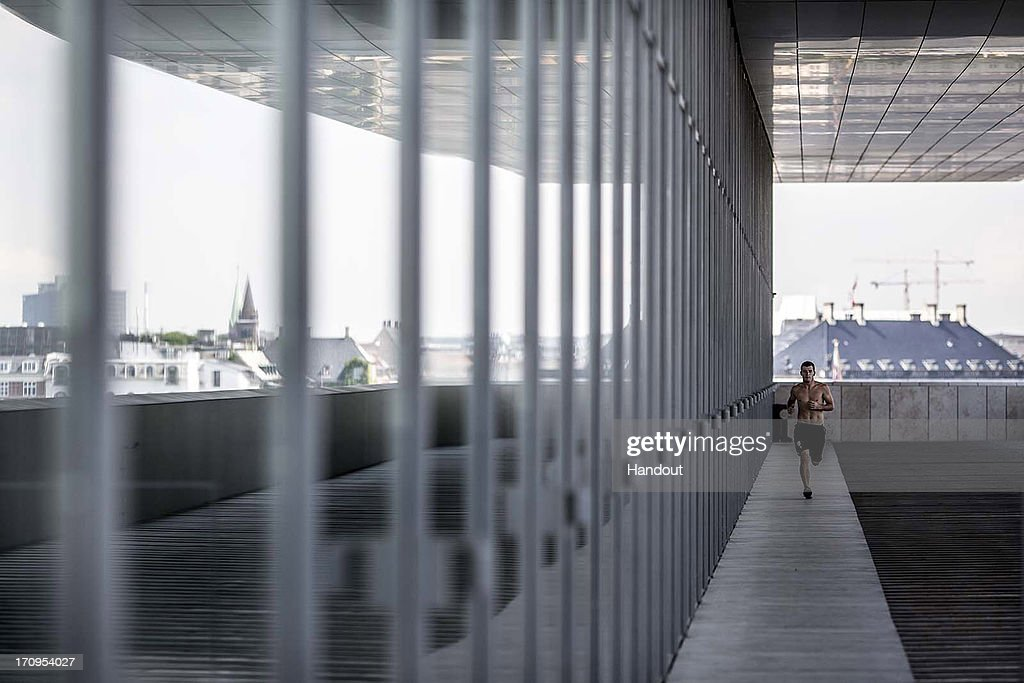 In this handout image provided by Red Bull, Steven LoBue of the USA runs around a balcony on the Copenhagen Opera House in preparation for the first practice session of second stop of the Red Bull Cliff Diving World Series on June 20, 2013 at Copenhagen, Denmark.
