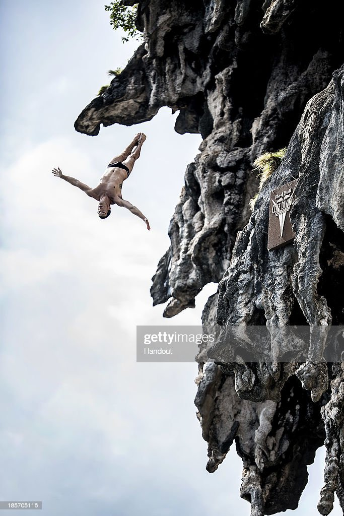 In this handout image provided by Red Bull, Steven LoBue of the USA dives from a 25 metre rock at Viking Caves in the Andaman Sea during competition on the fifth day of the final stop of the 2013 Red Bull Cliff Diving World Series on October 24, 2013 at Phi Phi Island, Thailand.