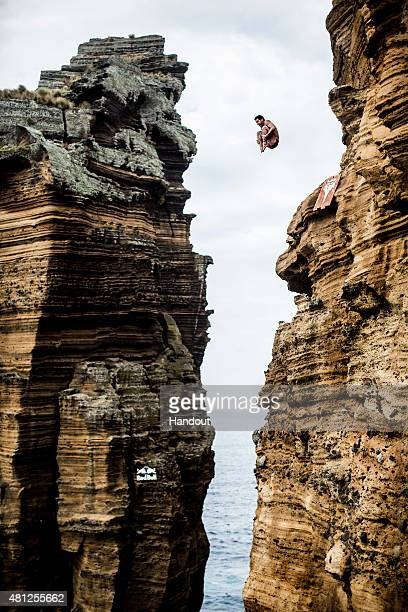In this handout image provided by Red Bull Steven LoBue of the USA dives from the 27 metre cliff face during the fifth stop of the Red Bull Cliff...