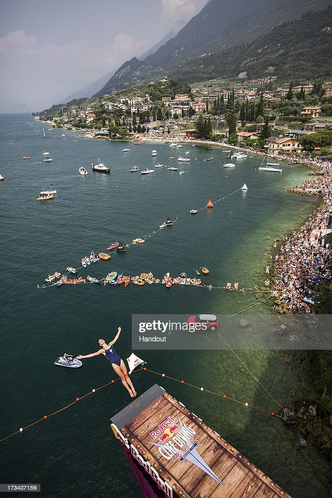 In this handout image provided by Red Bull, Tara Hyer-Tira of the USA dives from the 20 metre platform at the Scaliger Castle during the first Red Bull Cliff Diving Women's Competition on July 13, 2013 at Malcesine, Italy.