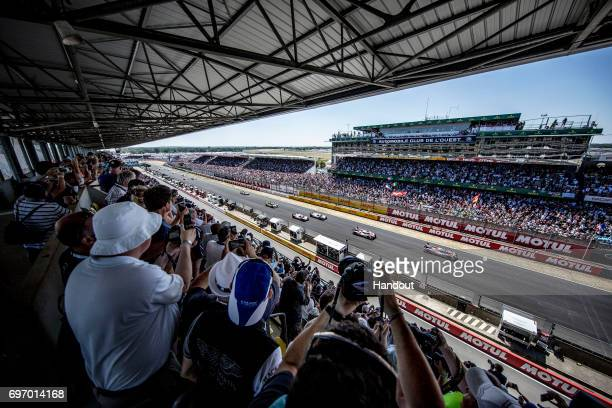 In this handout image provided by Red Bull The and Toyota TS050`s lead the and Porsche 919`s at the rolling start of the 24 Hours of Le Mans the...