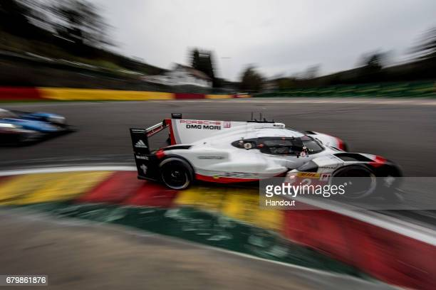 In this handout image provided by Red Bull The Porsche LMP1 car driven by Timo Bernhard of Germany and Earl Bamber and Brendon Hartley of New Zealand...