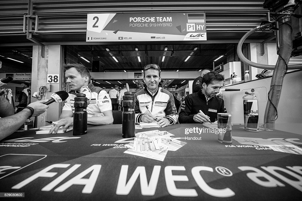 In this handout image provided by Red Bull, The #2 Porsche LMP1 car drivers (L-R) <a gi-track='captionPersonalityLinkClicked' href=/galleries/search?phrase=Marc+Lieb&family=editorial&specificpeople=3199675 ng-click='$event.stopPropagation()'>Marc Lieb</a> of Germany, <a gi-track='captionPersonalityLinkClicked' href=/galleries/search?phrase=Romain+Dumas&family=editorial&specificpeople=805197 ng-click='$event.stopPropagation()'>Romain Dumas</a> of France and <a gi-track='captionPersonalityLinkClicked' href=/galleries/search?phrase=Neel+Jani&family=editorial&specificpeople=541892 ng-click='$event.stopPropagation()'>Neel Jani</a> of Switzerland during the pit walk and autograph session prior to the 6 Hours of Spa-Francorchamps, the second round of the 2016 FIA World Endurance Championship's at Spa-Francorchamps Circuit on May 7, 2016 in Stavelot, Belgium.