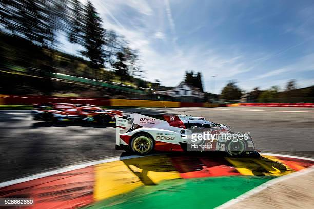 In this handout image provided by Red Bull The Toyota Gazoo Racing LMP1 car driven by Stephane Sarrazin of France Mike Conway of the UK and Kamui...