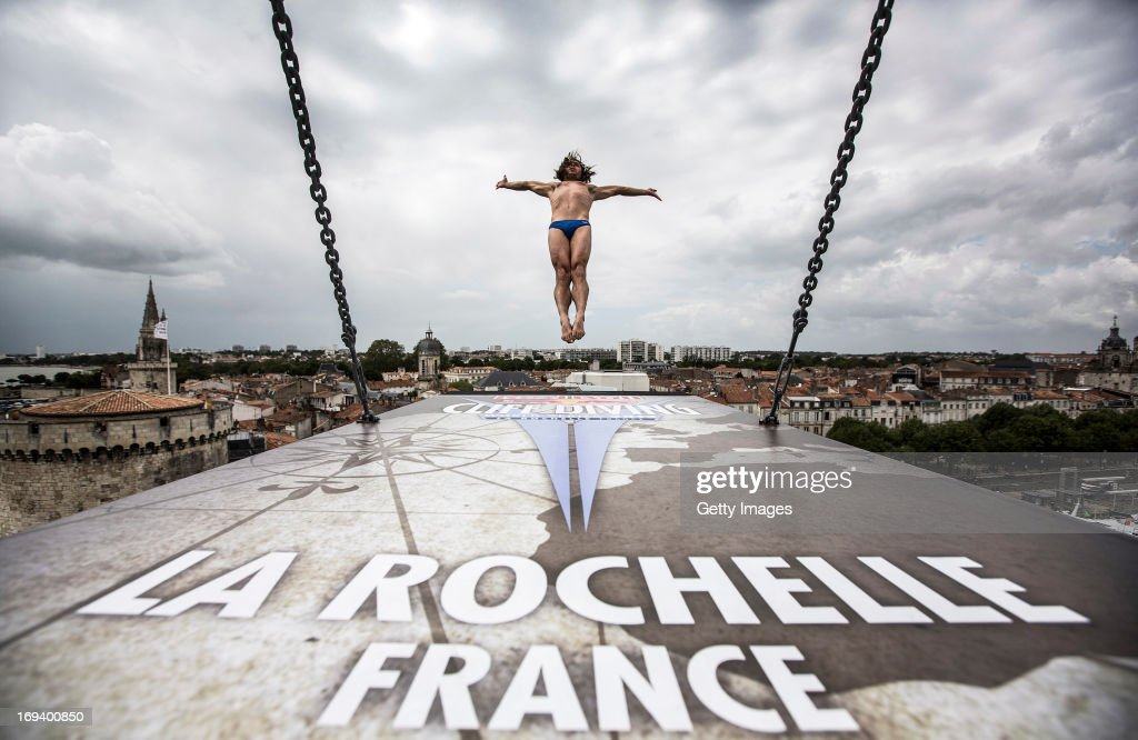 In this handout image provided by Red Bull, Todor Spasov of Bulgaria dives from the 27.5 metre platform on the Saint Nicolas Tower during the opening training session of the first stop of the Red Bull Cliff Diving World Series on May 23, 2013 at La Rochelle, France.