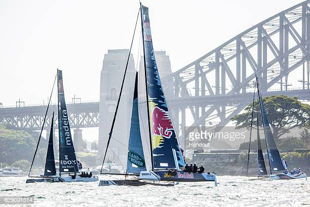 In this handout image provided by Red Bull Visit Madeira of Portugal Red Bull Sailing Team of Austria and Alinghi of Switzerland in their GC32...