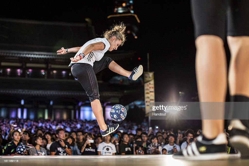 In this handout image provided by Red Bull, womens winner, Kitti Szasz of Hungary competes at Zojoji Temple during the Red Bull Street Style freestyle football world finals on September 19, 2013 at Tokyo, Japan.