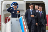 In this handout image provided by Ria Novosti Japanese Prime Minister Shinzo Abe arrives ahead of the G20 summit on September 4 2013 in St Petersburg...