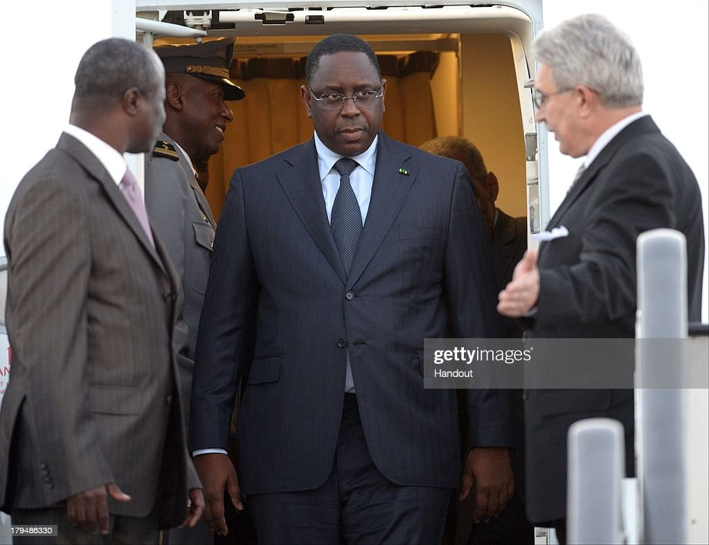 In this handout image provided by RIA Novosti, President of Senegal <a gi-track='captionPersonalityLinkClicked' href=/galleries/search?phrase=Macky+Sall&family=editorial&specificpeople=598630 ng-click='$event.stopPropagation()'>Macky Sall</a> arrives in Russia ahead of the G20 summit on September 4, 2013 in St. Petersburg, Russia. The G20 summit is scheduled to run between September 5th and 6th.