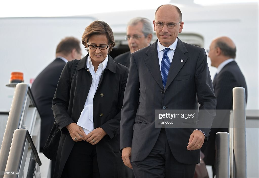In this handout image provided by Ria Novosti, President of the Council of Ministers of the Italian Republic <a gi-track='captionPersonalityLinkClicked' href=/galleries/search?phrase=Enrico+Letta&family=editorial&specificpeople=2915592 ng-click='$event.stopPropagation()'>Enrico Letta</a> and his wife Gianna Fregonara arrive in Russia ahead of the G20 summit on September 4, 2013 in St. Petersburg, Russia. World leaders are arriving in Russia ahead of the start of the G20 summit which is scheduled to run between September 5th and 6th.